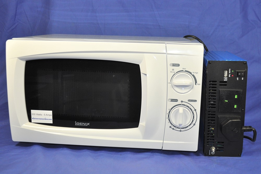 24 Volt Inverter And White 500 Watt Microwave Oven