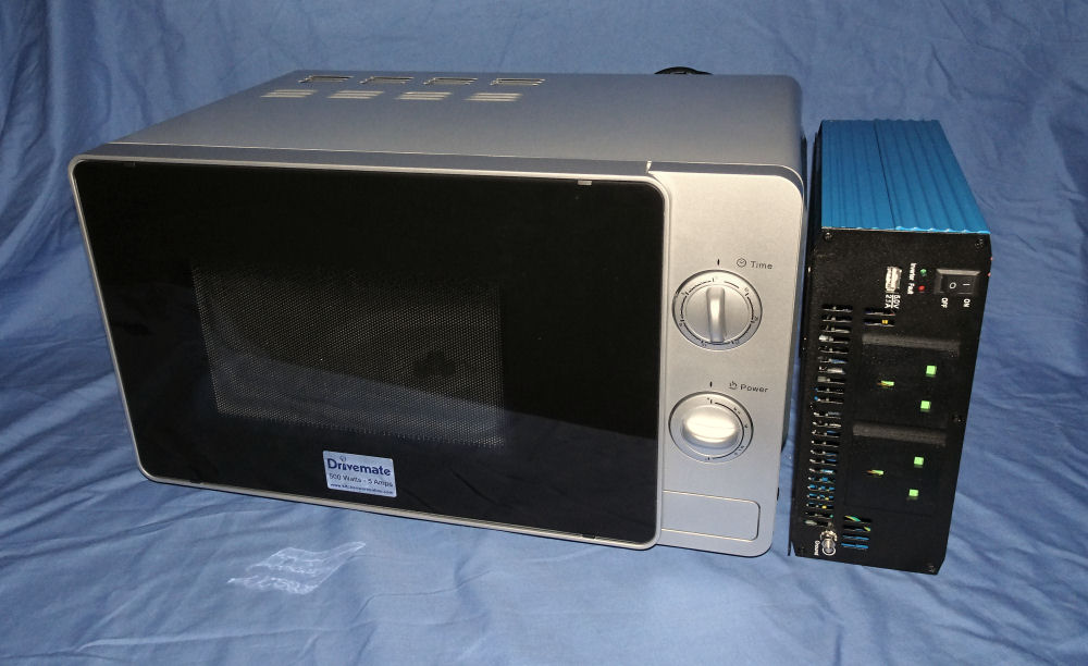 24 Volt Inverter and Silver 500 Watt Microwave Oven