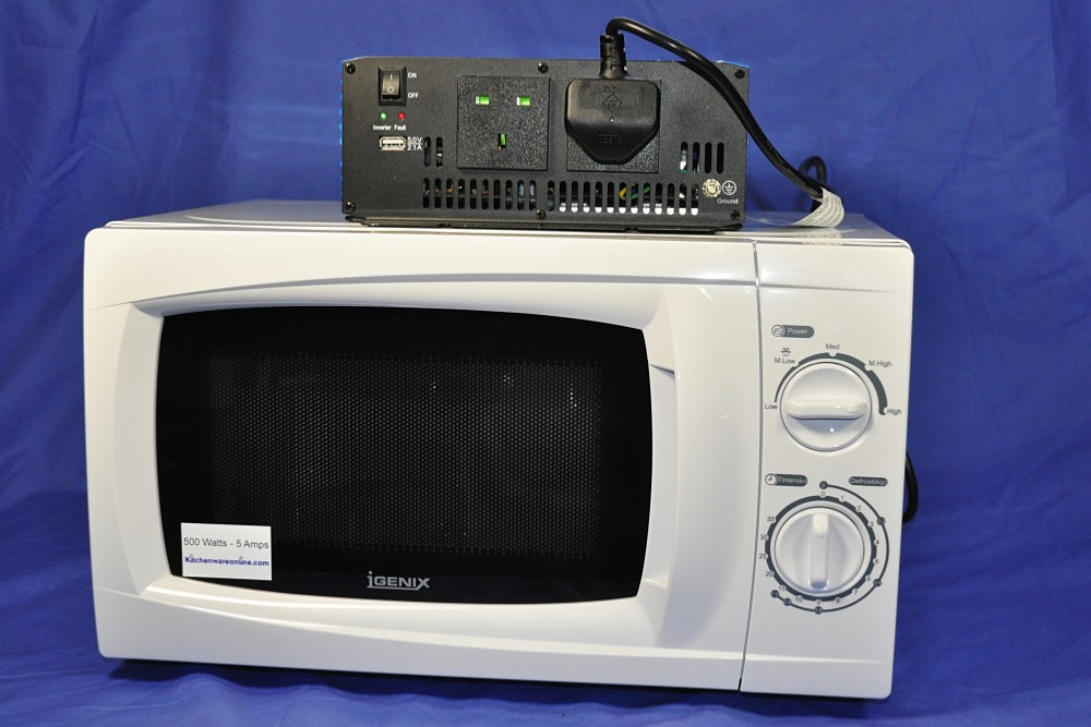 24 Volt Inverter And White 500 Watt Microwave Oven